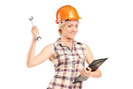 Female mechanic holding wrench