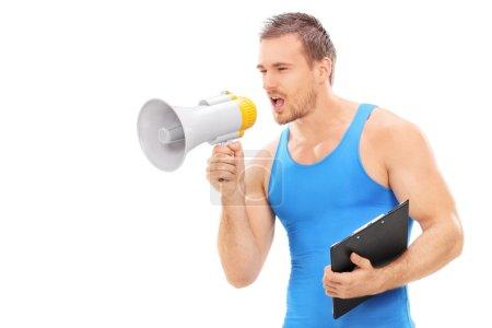 Fitness instructor shouting on megaphone