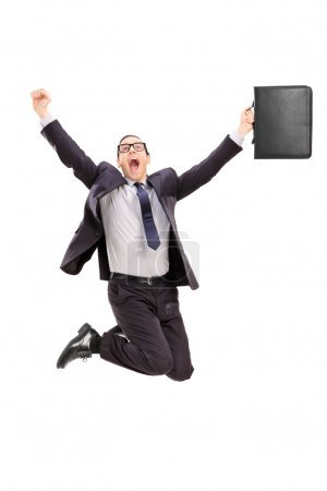 Businessman jumping out of joy