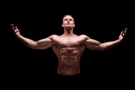 Muscular man gesturing with hands