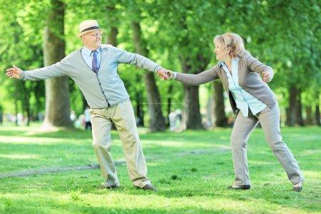 Mature couple having fun in park