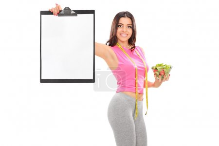 Woman holding salad and clipboard
