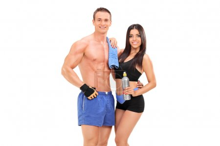 Athletic couple with water bottle