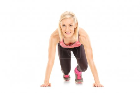 Female sprinter in starting position