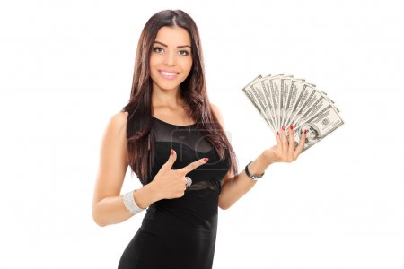 Woman pointing towards stack of money