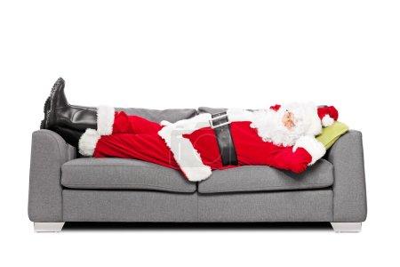 Santa Claus sleeping on sofa
