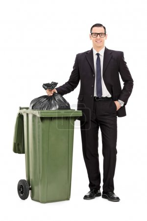 Businessman taking out trash