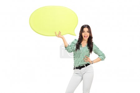 Young girl holding speech bubble