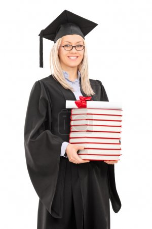 Photo for Female graduate student holding a stack of books isolated on white background - Royalty Free Image