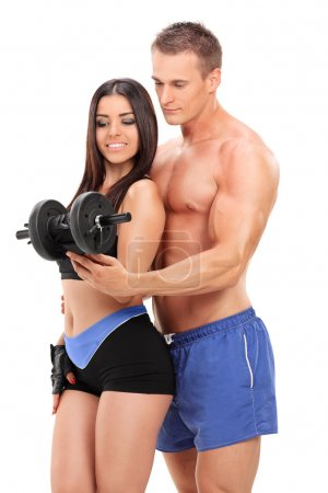 Attractive couple exercising with weight
