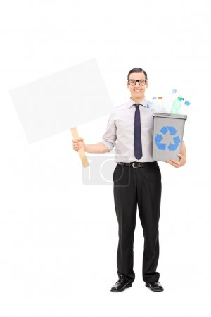 Man holding recycle bin and banner