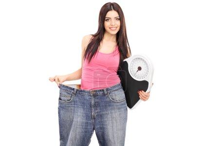 Girl in oversized jeans