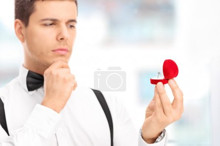 Man choosing an engagement ring