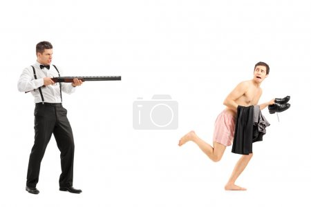Man chasing naked guy with rifle