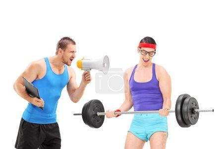 Fitness coach motivating nerdy guy