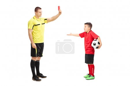 Football referee showing red card