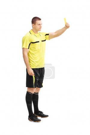 Football referee showing yellow card