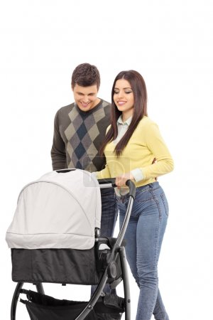 Young parents pushing baby stroller