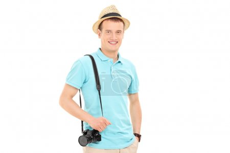 Young male tourist posing