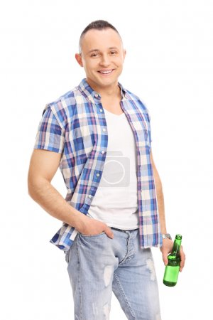 Young guy holding bottle of beer