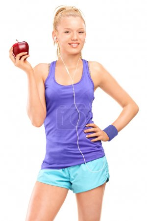 Blond woman holding red apple