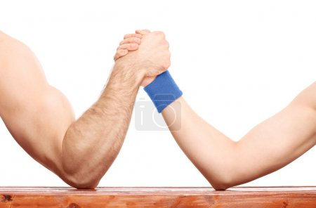 Arm wrestling between muscular and skinny