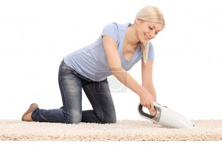 Woman with handheld vacuum cleaner