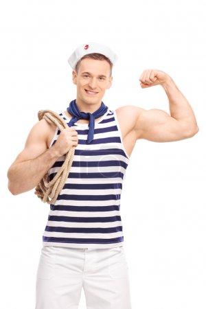 Photo for Vertical shot of a male sailor carrying a rope around his shoulder and showing his bicep isolated on white background - Royalty Free Image