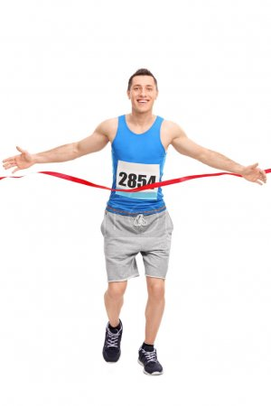 Male runner crossing the finish line