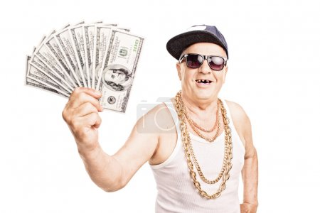 Toothless old man holding cash