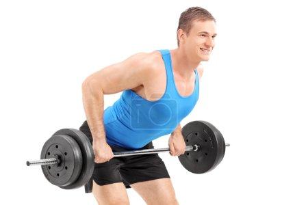 Muscular bodybuilder lifting a weight