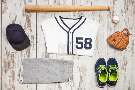 Bunch of sportswear and baseball equipment