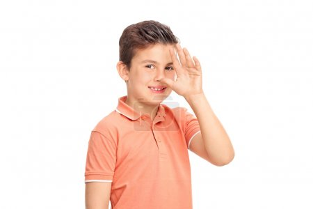 boy making a childish hand gesture