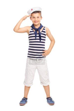 little kid in a sailor uniform saluting