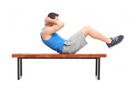 male athlete doing stomach crunches