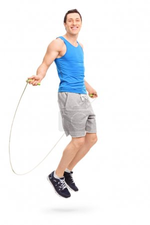 Young athlete exercising with a skipping rope