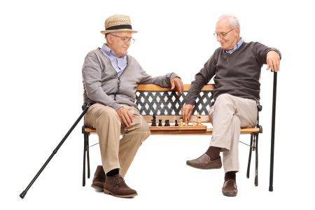Two seniors men playing chess