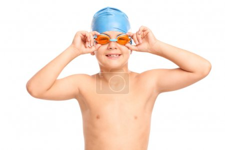 boy with swimming goggles and swim cap