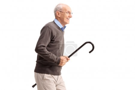 Joyful senior gentleman carrying a cane
