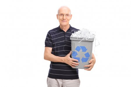 Senior holding a recycle bin