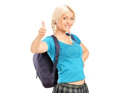 Schoolgirl giving a thumb up