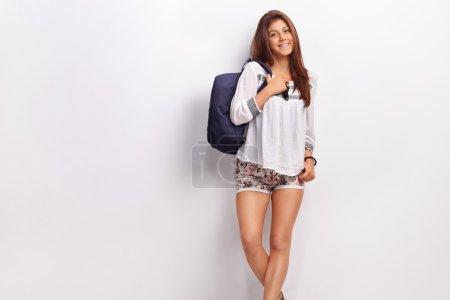 Teenage schoolgirl with a blue backpack