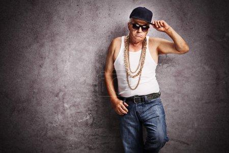 Senior gangster in baggy hip-hop clothes
