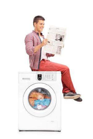Man waiting for the washing machine to finish
