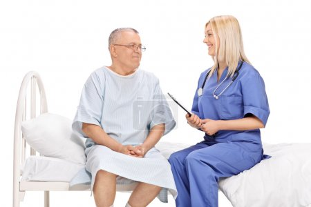 Patient and a female doctor having conversation