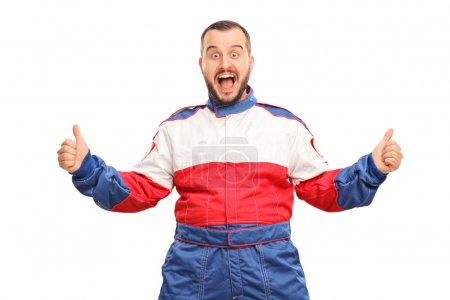 Photo for Studio shot of an overjoyed car racer gesturing happiness and looking at the camera isolated on white background - Royalty Free Image