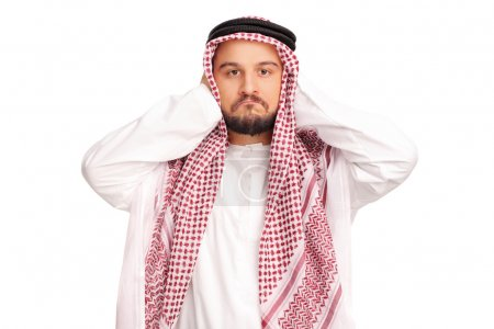male Arab covering his ears