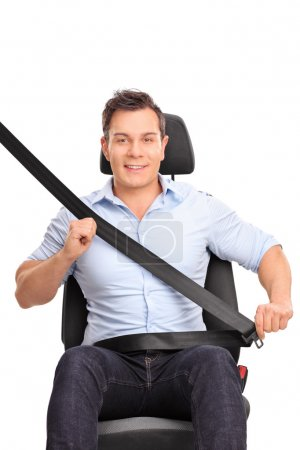 Photo for Frontal vertical shot of a young man sitting on a car seat and fastening his seat belt isolated on white background - Royalty Free Image