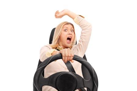 Terrified woman before a car crash