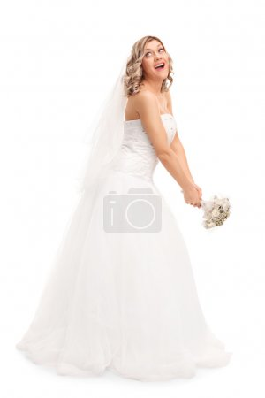 Young bride tossing her wedding bouquet